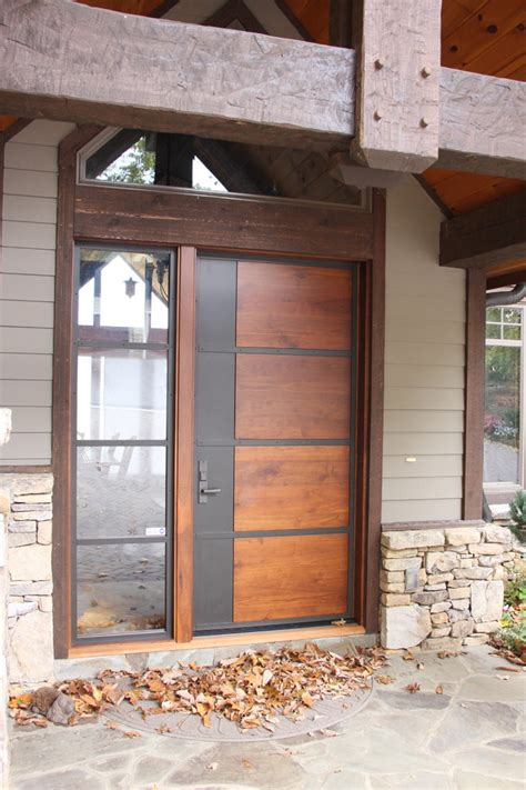 rustic metal doors entry modern  stone exterior stone siding vertical windows czmcamorg