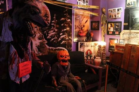 This bedroom wall creates special enclaves to mark the bed and showcase finer things. Parts of the 2nd horror movie room - Picture of Wolf's Museum of Mystery, St. Augustine ...