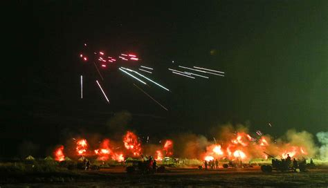 Chinese 57mm anti-aircraft guns firing at night [2626 x ...