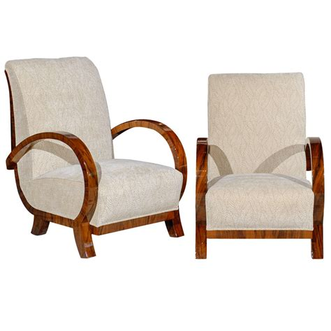 pair of curved arm deco chairs at 1stdibs
