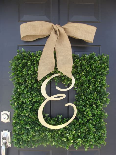 square boxwood wreaths   created    inches  paired  letters  large