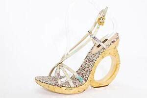 louis vuitton womens gold high heel sculpted wedge pump