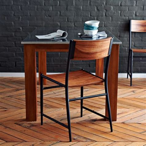 west elm s studio chair features slightly tapered legs and