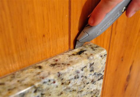 removing cabinets patching a vinyl floor tile