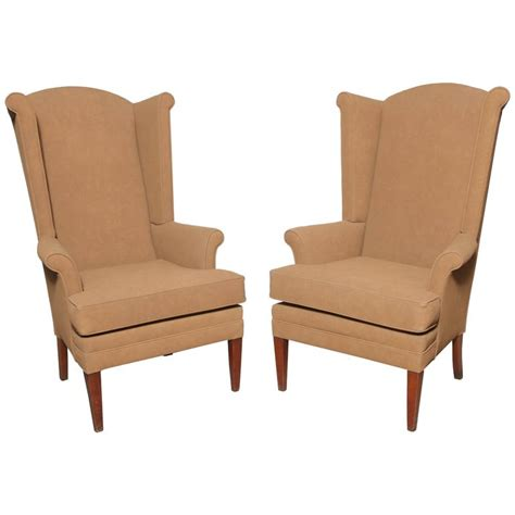 pair of narrow mid century camel highback wingback