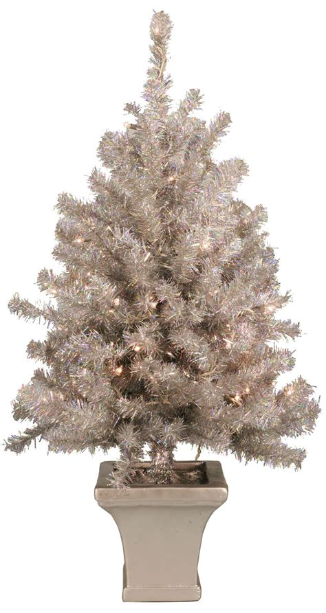 artificial christmas trees  potted silver laser table
