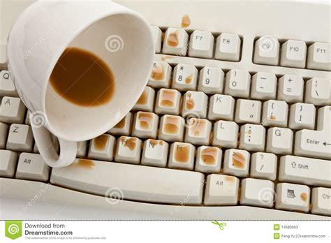 Coffee And Damaged Computer Keyboard Stock Image   Image: 14583663