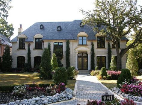 slate grayblack roof copper aged door window  gutter french house french style homes