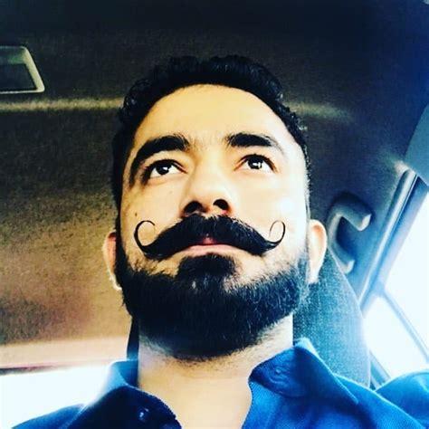 style short beard accompanied   long mustache