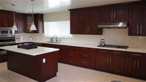 White kitchen cabinets with pulls and knobs, red mahogany