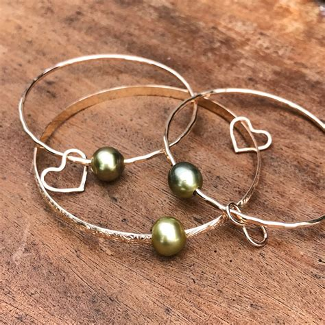 Pistachio Tahitian Pearl Bangle Bracelet  Kailua Jewelry. Manufactured Diamond. Prism Watches. Wide Band Anniversary Rings. Modernist Engagement Rings. Tanishq Bracelet. Shell Earrings. Personalised Rings. Wide Diamond Eternity Band
