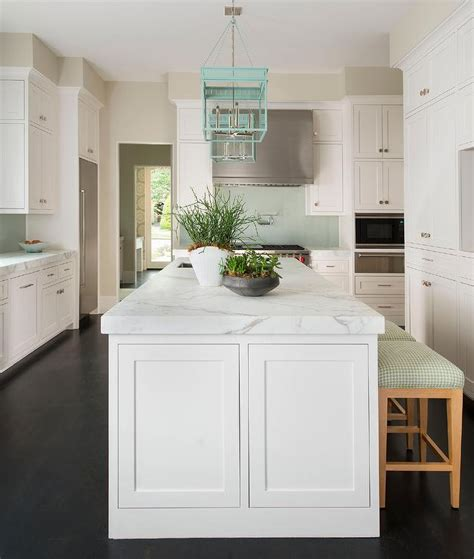 White Kitchen Island with Turquoise Lanterns and Mint