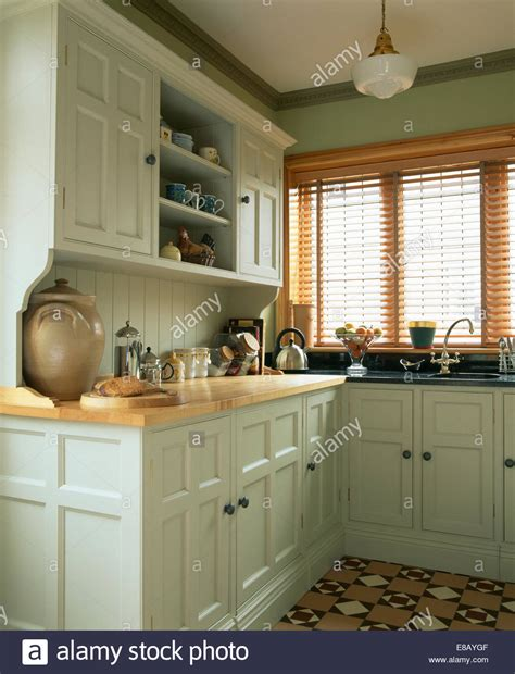 pastel green kitchen slatted wooden blind on window in kitchen in traditional 1421