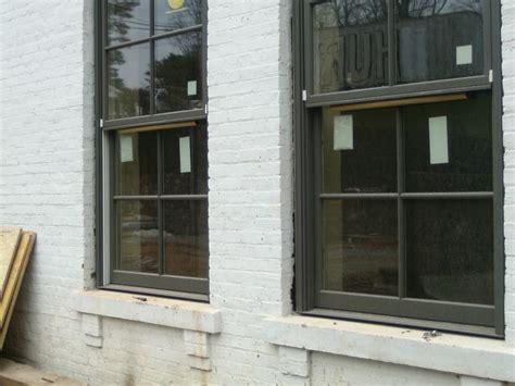 pella deep olive window color trim pella windows white brick houses mountain home
