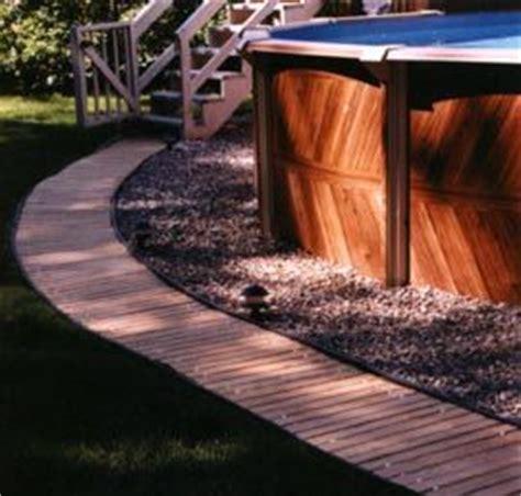 wooden walkway   pool   barefeet