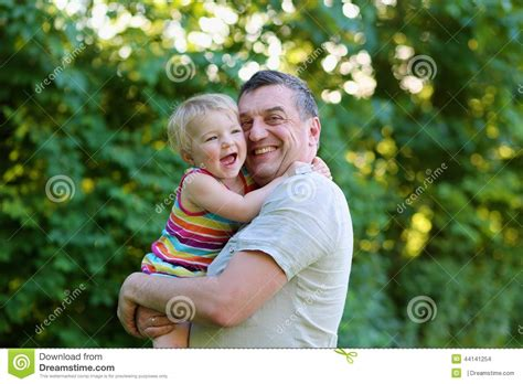 Happiness. Father Kissing His Daughter Outdoors Stock