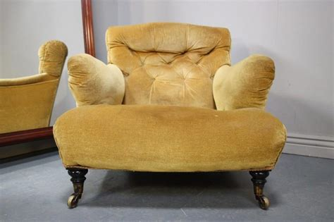 Antique Upholstered Armchair. Very Howardesque.