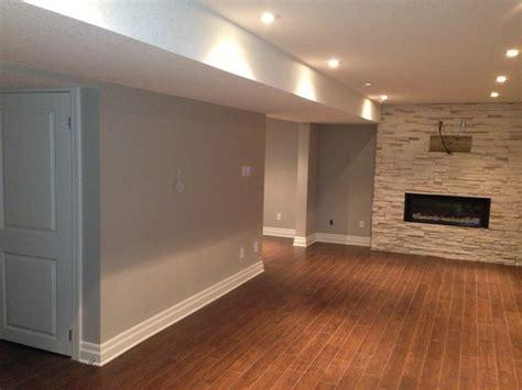 laminate wood flooring basement custom renovations jakenzi design build laminate floor in basement vendermicasa