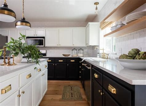 Great savings & free delivery / collection on many items. Large black and white kitchen boasting brushed gold cup pulls on perimeter cabinets and a ...