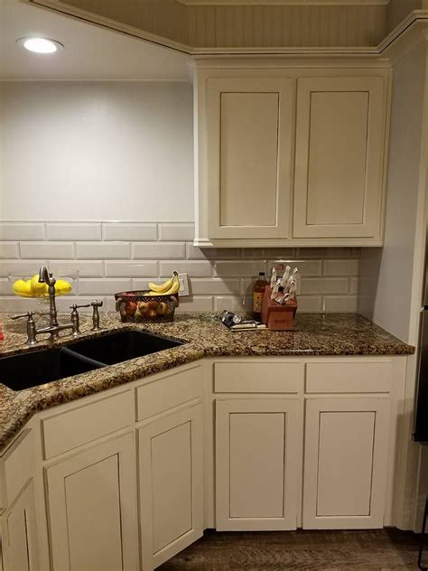 Cheap kitchen backsplash ideas it doesn t take a big budget to install kitchen backsplash that is protective and stylish some tips can help you having cool kitchen a kitchen backsplash is the opportunity to make a style statement. Kitchen cabinets. Baltic Brown counter. Glazed cream ...