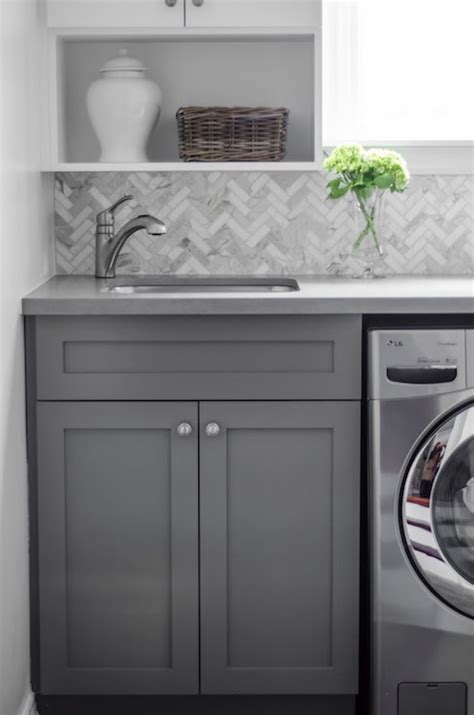 marble herringbone backsplash calacatta marble herringbone tiles transitional laundry room well nested interiors