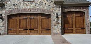 Carriage wooden garage doors by carriage house door company for Carriage style garage doors kit