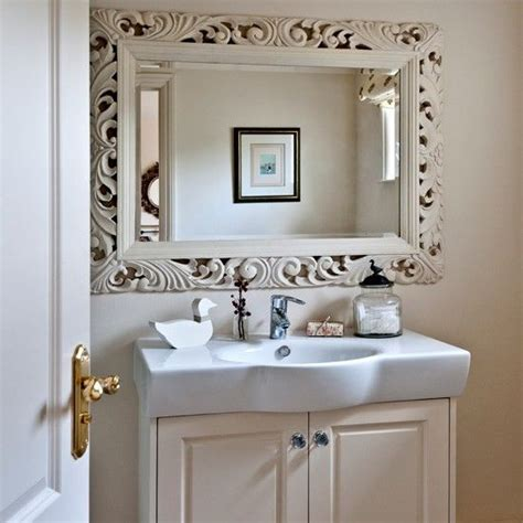How To Decorate A Bathroom Mirror by Neutral Bathroom With Dramatic Mirror Country Decorating