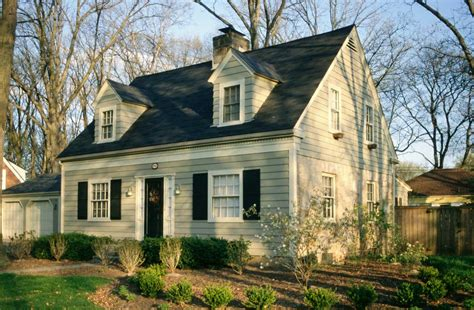 cape cod style homes with light green wall paint color