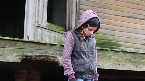 Sad Teen Girl With Earphones Hoodie Standing Train