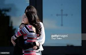 Mourners comfort each other outside Holy Trinity Catholic ...