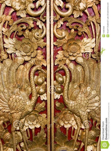 door carving  pura masceti bali indonesia stock photo