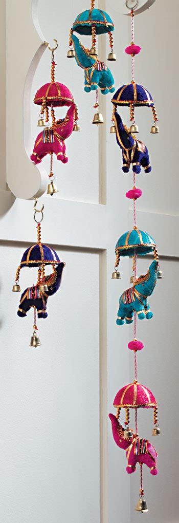 string   indian elephants  umbrellas indian