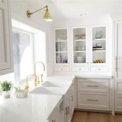 white kitchen sink faucet dual apron sink with gold gooseneck faucet transitional kitchen