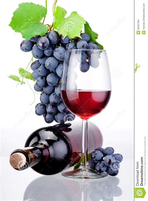 bottle  glass  red wine bunch  grapes  leaves