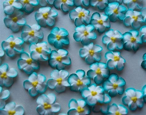 teal tipped white royal icing flowers handmade cake