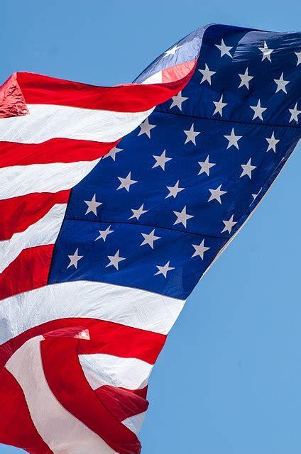 american flag waving  photo  pixabay