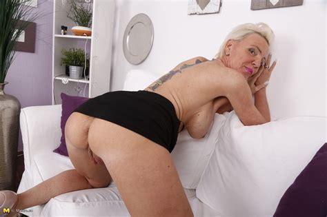 german mature chick has fantastic big fake tits
