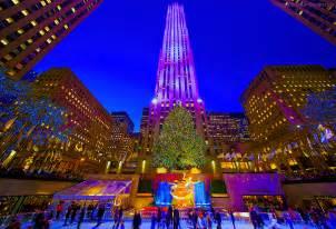 nyc s rock center christmas tree glistens and glitters at twilight inga s angle