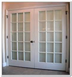 french doors exterior with built in blinds interior