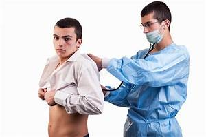 Doctor Examine A Young Man Patient With Stethoscope Stock ...
