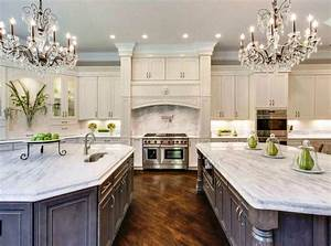 beautiful-kitchen-with-white-cabinets-two-islands-two