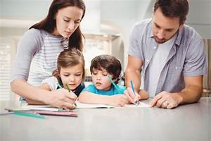 Family Writing In Book Photo Premium Download