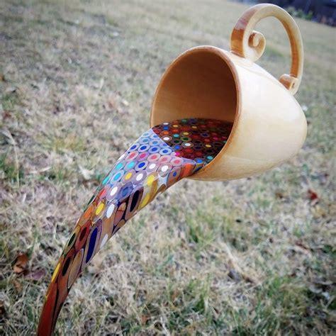 woodworking artist carves floating mug sculpture