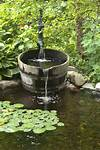 Aquascape Your Landscape: Designing Your Dream Pond outdoor water fountain garden pond