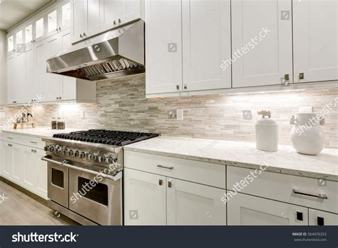shaker kitchen tiles gourmet kitchen features white shaker cabinets stock photo 2175