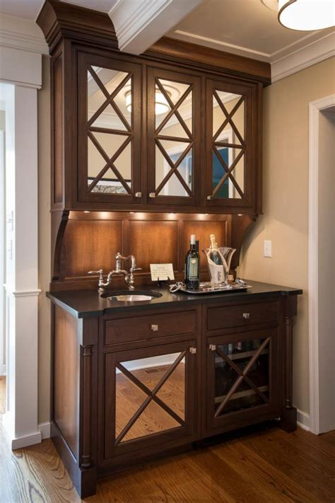 classy wet bar features mirrored cabinet doors hgtv