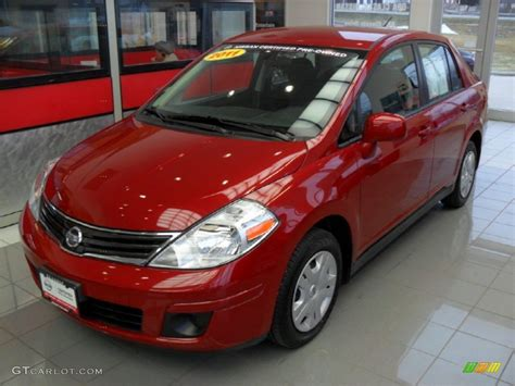 red nissan versa 2011 red brick nissan versa 1 8 s sedan 60045619 photo