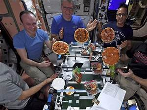 Astronauts make, fling, float, eat pizzas on space station ...