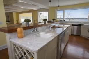 carrara marble kitchen island white carrara counter with butcher block raised bar