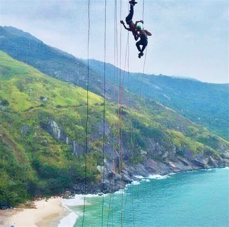 Man Hanging Off Cliff But What His Doing
